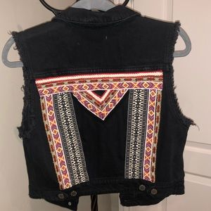 Black vest with unique design on the back.